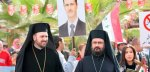 Two Syrian Orthodox priests wait for the