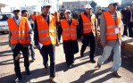Arab League observer members tour the village of Dael in Daraa province2