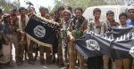 Army soldiers display flags of the al Qaeda-linked Ansar al-Sharia group, at a position recaptured from thr group near the southern Yemeni city of Zinjibar
