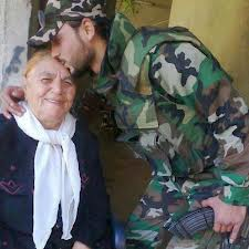syrian-soldier-kissing-the-head-of-old-woman