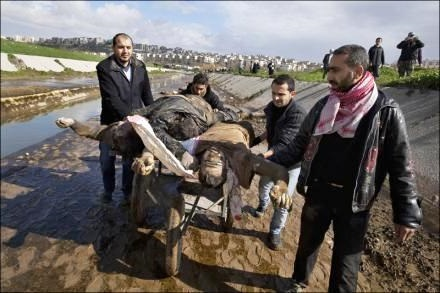 wounded-man-and-terrorist-in-syria