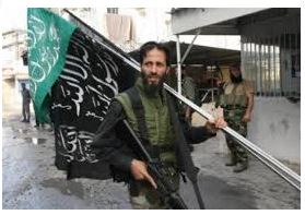one of the many terrorists mercenaries supported by Obama and Europe tokill and eat organs of the people in Syria