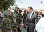 Dr Bashar al-Assad greets his troops