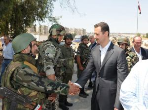 Dr Bashar al-Assad greets his troops