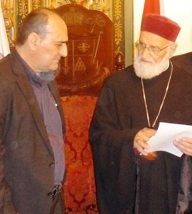 Patriarch Laham talking to journalist F.F. Pilato