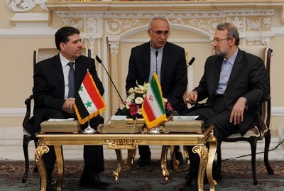 Wael al-Halqi and Chairman of the Iranian Shura Council-Ali Larijani