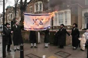 Jews burn Israeli flag