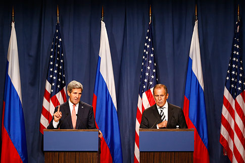 U.S. Secretary of State John Kerry and Russian Foreign Minister Sergei Lavrov speak, following meetings regarding Syria, at a news conference in Geneva