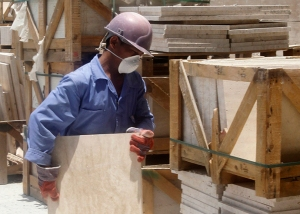 A labourer works at a construction site in Doha