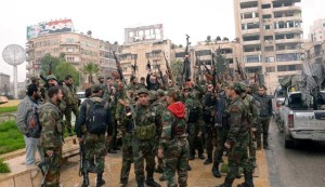 100 armed men surrender to Syrian Army