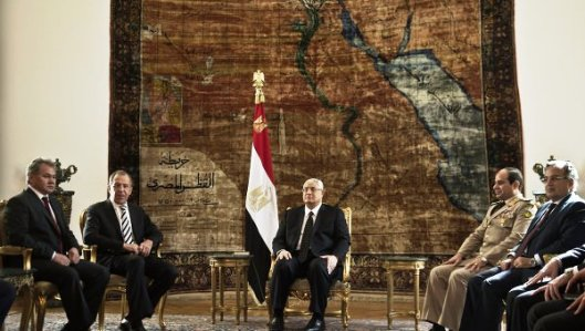 Egypt's interim president Adly Mansour (C) defense minister Abdlefatah al-Sissi (2ndR) meet with Russian Foreign Minister Sergey Lavrov (2-L), and Russian Defense Minister Sergei Shoigu (L) on November 14, 2013 at the presidential palace in Cairo.