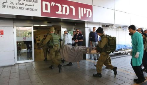 A Syrian wounded in fighting within Syria is carried into Rambam Hospital in the northern Israeli city of Haifa (Reuters)
