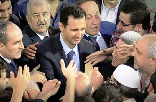 Assad surrounded by people in Damascus mosque