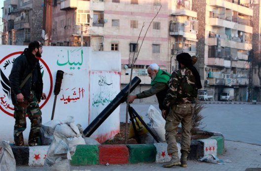 Free Syrian Army fighters prepare to launch a mortar towards fighters from the Islamic State in Iraq and the Levant (ISIL) from a street in the Kadi Askar neighbourhood of Aleppo, after seizing it from the ISIL, activists said, January 7, 2014.(Reuters / Abdalrhman Ismail)