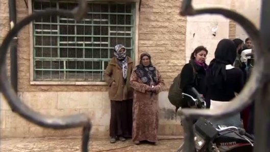 Refugees returning to a village just outside Aleppo, after the Syrian army took control.
