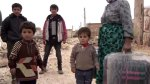 Refugees returning to a village just outside Aleppo after the Syrian army took control