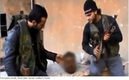 Terrorists_insult_feed_slain_Syrian_soldier_s_head