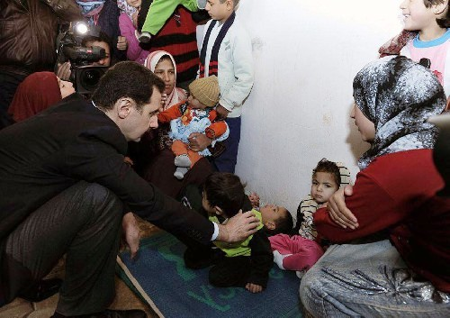 Bashar al-Assad visits displaced people at al-Dweir shelter in Adra
