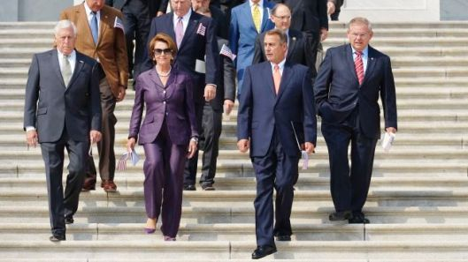 US Congress members walk down the stairs at the Capitol Hill
