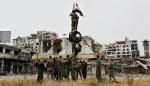 Syrian army hoisting their flag in liberated old city Homs