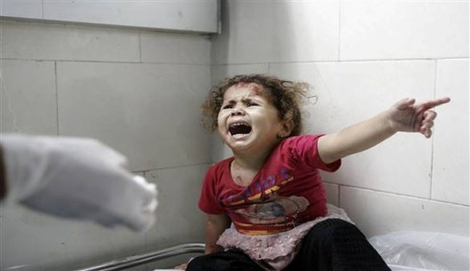 A Palestinian child shouts at al-Shifa hospital after Israeli forces shelled her house in Gaza City - AlAlam photo