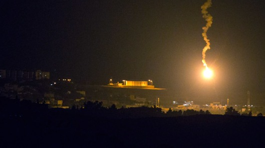 A picture taken from the southern Israeli border with the Gaza Strip shows Israeli flares illuminating the Palestinian coastal enclave, on July 7, 2014.(AFP Photo / Jack Guez)