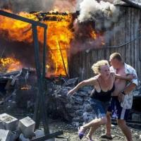 Ukraine Crimes: dozens civilians killed and orphanage destroyed by Kiev's nazi psychopaths who are urging Russia not to accept orphans fleeing war zones while their artillery hits the Russian region of Rostov