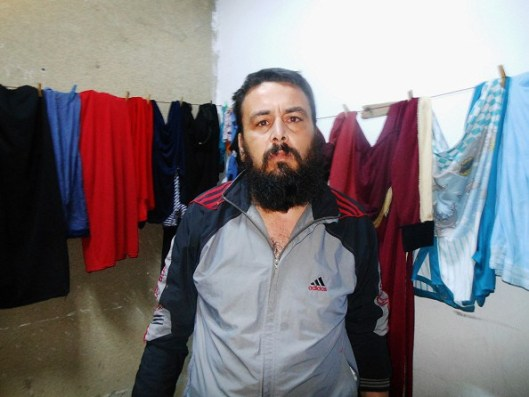 Harem refugee in Latakia centre speaks of atrocities committed by foreign insurgents. Photo by Eva Bartlett.