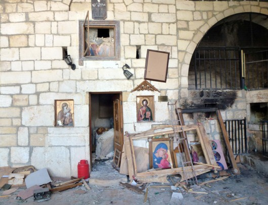 Destroyed religious icons are pictured inside a church in the ancient Christian town of Maalula on April 20, 2014. (AFP Photo / Rim Haddad)