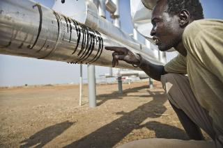 A_man_examines_a_leaking_oil_pipe_line_at_a_pumping_station_built_next_to_his_village_on_land_that_was_once_used_for_agriculture_Paloch_South_Sudan_Jan-_20_2010-_Courtesy_of_Sven_Torfinn-98943