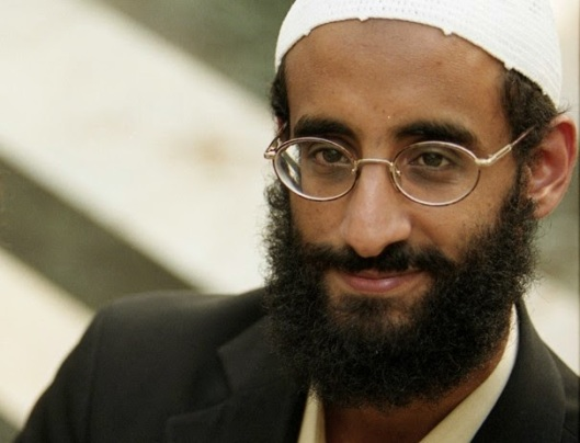 "Image: Just another coincidence ... Senior Al Qaeda leader Anwar Al Awlaki was clicking glasses together at the Pentagon with American military brass just months after the 9/11 attacks in 2001. Also, ""coincidentally,"" he had in fact met at least one of the several alleged hijackers. He also, just before being liquidated by a US drone attack in 2011, allegedly funded the terror cell responsible for the recent Paris shootings."