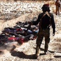 The takfiris criminals of Daesh (ISIS) massacred 13 boys in Mosul because they watched a football game on TV
