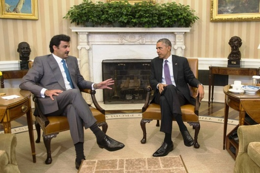 President Barack Obama and the Emir of Qatar, Tamim bin Hamad al-Thani, left, speak during a bilateral meeting in the Oval Office on Tuesday.  (Photo: Agence France-Presse/Getty Images)