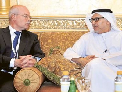 Clemens von Goetze (Director of the 3rd Department of the German Foreign Affairs Ministry) and Anwar Mohammad Gargash (Emirati Minister of Foreign Affairs), at a meeting of the working group on the carving up of the Syrian economy at Abou Dhabi.