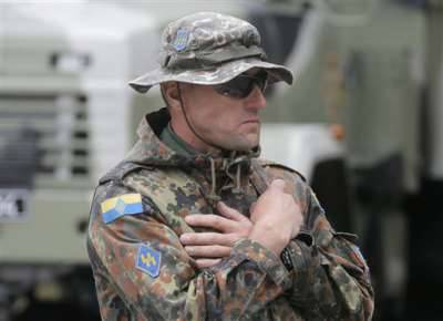 Ukrainian soldier openly wearing Nazi SS insignia