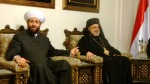 Grand Mufti Ahmad Badr Al-Din Hassoun and Syrian Greek Orthodox Bishop Luca al-Khoury