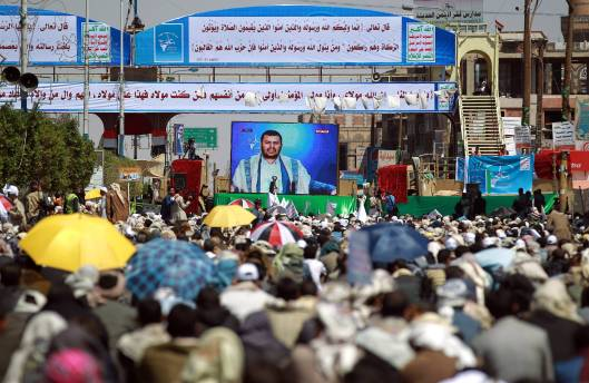 People listening to Houthis leader Abdul-Malik al-Houthi