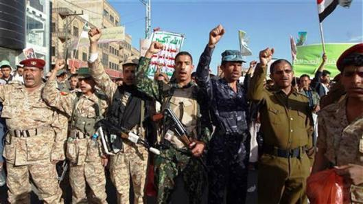 Yemeni  fighters of the Houthi movement
