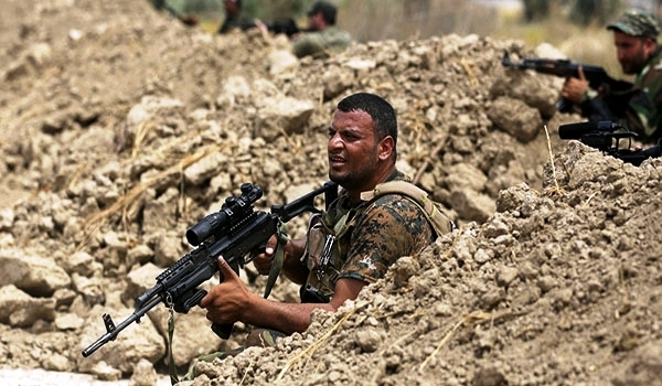 Iraqi Volunteers Find Israeli Arms in ISIL Position