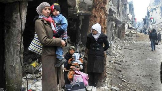 Residents of the Yarmouk Palestinian refugee camp