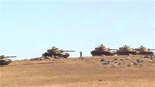 Turkish tanks are seen near the border with Syria on 20150629