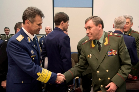 Left and right: General Stefan Danila (Chief of Defence, Romania) shaking hands with Col. General Valery Gerasimov (Chief of Defence, Russian Federation)