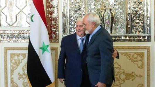 Syrian Foreign Minister Walid al-Muallem-with Iranian Mohammad Javad Zarif