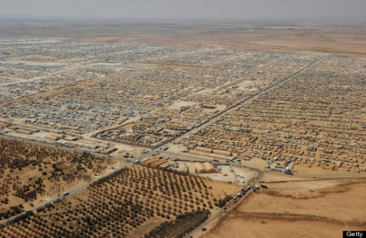 An aerial view shows the Zaatari refugee camp near the Jordanian city of Mafraq, some 8 kilometers from the Jordanian-Syrian border. The northern Jordanian Zaatari refugee camp, now home to 160,000 Syrians, equal in size to what would be Jordan's fifth-largest city. AFP PHOTO/MANDEL NGAN/POOL        (Photo credit should read MANDEL NGAN/AFP/Getty Images)