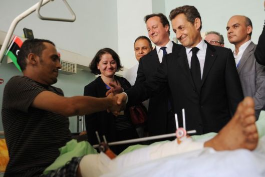 french-president-nicolas-sarkozy-and-british-prime-minister-david-cameron-shake-hands-with-a-wounded-nato-mercenary-terrorist-tripoli-medical-centre-15-september-2011