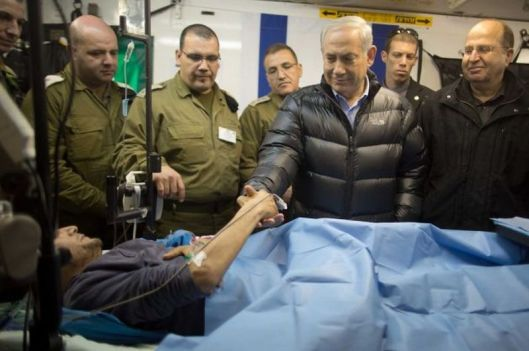 israeli-prime-minister-benjamin-netanyahu-shakes-hands-with-an-wounded-mercenary-terrorist-israeli-military-field-hospital-near-israel-syria-border-in-occupied-golan-18-february-2014