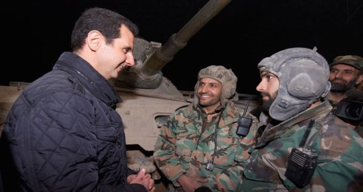President Bashar Hafez al-Assad with the Syrian Arab Army soldiers on the battlefield ground, on the night of the eve of the new year, 1 January 2015