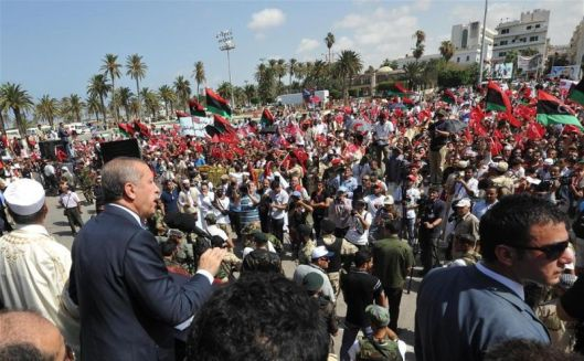 turkeys-pm-recep-tayyip-erdogan-delivers-a-speech-to-a-crowd-waving-flags-of-turkey-and-libyas-national-transitional-council-government-green-square-tripoli-16-september-2011