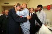 turkeys-prime-minister-recep-tayyip-erdogan-and-libyan-irish-activist-mahdi-al-harati-ataturk-hospital-ankara-3-june-2010