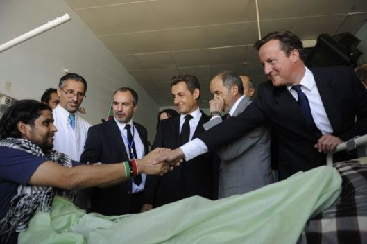 uk-pm-david-cameron-french-president-nicolas-sarkozy-libyas-president-mustafa-abdul-jalil-and-a-wounded-nato-mercenary-terrorist-tripoli-medical-centre-15-september-2011